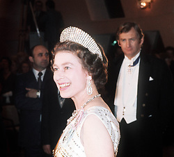 Queen Elizabeth II at a state banquet in Luxembourg, wearing the George III Fringe Tiara