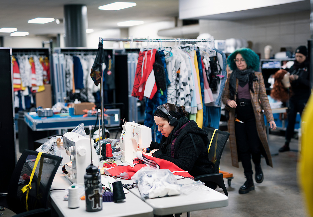 """A costume designer mends an outfit for """"Cirque du Soleil: CRYSTAL"""" backstage during rehearsal at the Alliant Energy Center in Madison, WI on Wednesday, May 1, 2019."""
