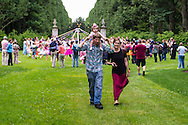 Old Westbury, New York, USA. 28th June 2015. Lori Belilove & The Isadora Duncan Dance Company give Maypole Dance lessons to children, as families watch and walk on the South Allee of historic Old Westbury Gardens, a Long Island Gold Coast estate, for its Midsummer Night event.