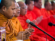 11 AUGUST 2015 - BANGKOK, THAILAND: Buddhist monks chant at a service to honor Queen Sirikit of Thailand before her 83rd birthday. Queen Sirikit was born Mom Rajawongse Sirikit Kitiyakara on August 12, 1932. She is the queen consort of Bhumibol Adulyadej, King (Rama IX) of Thailand. She met Bhumibol in Paris, where her father was the Thai ambassador. They married in 1950, she was appointed Queen Regent in 1956. The King and Queen had one son and three daughters. She has not made any public appearances since her hospitalization in 2012. Her birthday is celebrated as Mother's Day in Thailand, schools and temples across Thailand hold ceremonies to honor the Queen and mothers.      PHOTO BY JACK KURTZ