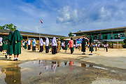 11 JULY 2013 - PATTANI, PATTANI, THAILAND:   Students at assembly at the Bantaladnadklongkud School in Pattani.  There are 108 students at Bantaladnadklongkud School and they are all Muslims. Five of the school's eight teachers are Buddhists.    PHOTO BY JACK KURTZ