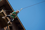 Lexi Mace jumps off the zipline platform at The Ridges on Parents Weekend. Photo by Hannah Ruhoff