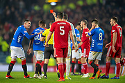 Referee Steven McLean shows Alfredo Morelos (#20) of Rangers FC a red card during the Ladbrokes Scottish Premiership match between Rangers and Aberdeen at Ibrox, Glasgow, Scotland on 5 December 2018.