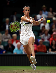 Magdalena Rybarikova in action against Coco Vandeweghe on day eight of the Wimbledon Championships at The All England Lawn Tennis and Croquet Club, Wimbledon.