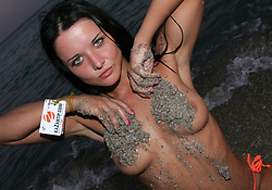 A Russian model poses naked in the sea. Kazantip has been going for 15 years and is the rival to Ibiza. This electronic music festival lasts a month and boosts over 400 DJ's where the young and the beautiful from across Russia and the Ukraine enjoy their summer. Popovka, Ukraine, 28th July 2007