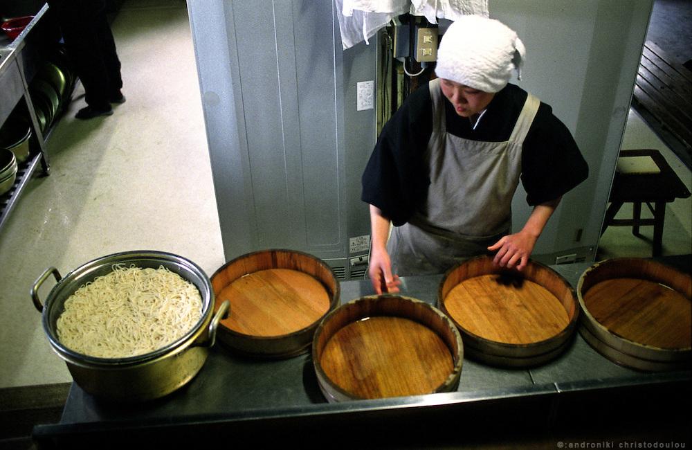 LIVING ZEN - HOSHINJI MONASTERY, OBAMA-JAPAN..Nun in the kitchen preparing lunch.