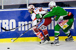20.01.2012, Hala Tivoli, Ljubljana, SLO, EBEL, HDD Tilia Olimpija vs EC KAC, im Bild David Schuller (EC KAC, #45) vs Brad Cole (HDD Tilia Olimpija, #2) // during ice-hockey match between HDD Tilia Olimpija and EC KAC in 44th Round of EBEL league, on Januar 20, 2012 at Hala Tivoli, Ljubljana, Slovenia. EXPA Pictures © 2012, PhotoCredit: EXPA/ Sportida/ Matic Klansek Velej..***** ATTENTION - OUT OF SLO *****