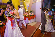 08 MARCH 2006 - HO CHI MINH CITY, VIETNAM: A wedding in Ho Chi Minh City, Vietnam. HCMC is still widely known as Saigon. PHOTO BY JACK KURTZ