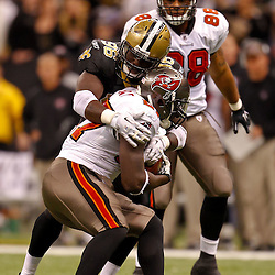 January 2, 2011; New Orleans, LA, USA; New Orleans Saints defensive end Alex Brown (96) tackles Tampa Bay Buccaneers running back LeGarrette Blount (27) during the fourth quarter at the Louisiana Superdome. The Buccaneers defeated the Saints 23-13. Mandatory Credit: Derick E. Hingle