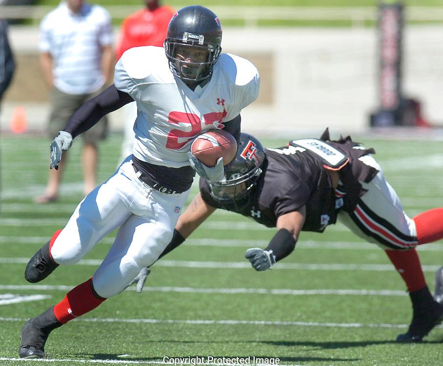 Jodi Miller Lubbock Avalanche-Journal.Texas Tech wide receiver Edward Britton, 27, makes corner back Marcus Bunton, 1, during the Red Raiders scrimmage Saturday afternoon at Jones Stadium.