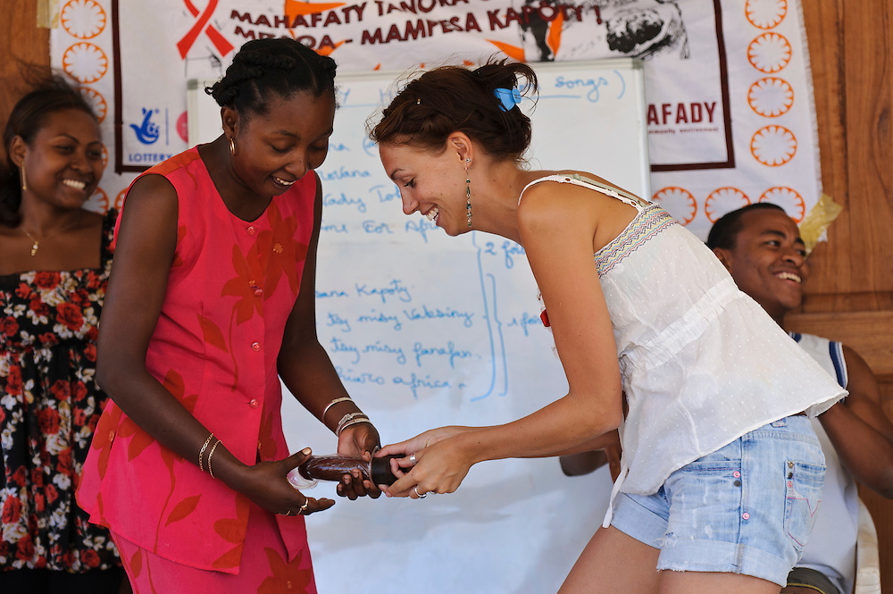Ailie Tam and peer educator Raheliarimanga Myriam demonstrating the use of female condoms, Fort Dauphin, Madagascar. Azafady's mission is to alleviate extreme poverty and protect endangered, biologically rich forest environments in Madagascar by empowering some of the poorest people to establish sustainable livelihoods and improve their health and wellbeing. Their aims are to raise awareness about the plight of the Madagascan environment and the Malagasy people; to empower Malagasy people to improve their own lives; and provide support to communities and threatened environments. Azafady's approach is one of co-operation and participation with grassroots communities working to alleviate the effects of poverty and to support viable, environmentally sensitive development. Their holistic development and conservation projects support some of the world's most vulnerable people in threatened & irreplaceable environments. At the heart of the charity's work is an integrated approach to the needs of the Malagasy people and their unique environment, sensitively built around what local people have told the charity are their most critical needs and which maximises community participation. Azafady develop projects using the Sustainable Livelihoods model for poverty reduction, which aims to reduce vulnerability by strengthening communities' human, natural, financial, social and physical assets with a caveat that the charity's projects and activities do not compromise the environment. Projects incorporate communication, training and support at the level of the Fokontany (village) and the household, with a priority for the most isolated and marginalised communities. The charity has recently recruited a Research, Monitoring and Evaluation Manager, who will implement Azafady's new HIV/AIDS activities with pregnant and married women, with the aim of reducing rates of maternal transmission of HIV within the town.