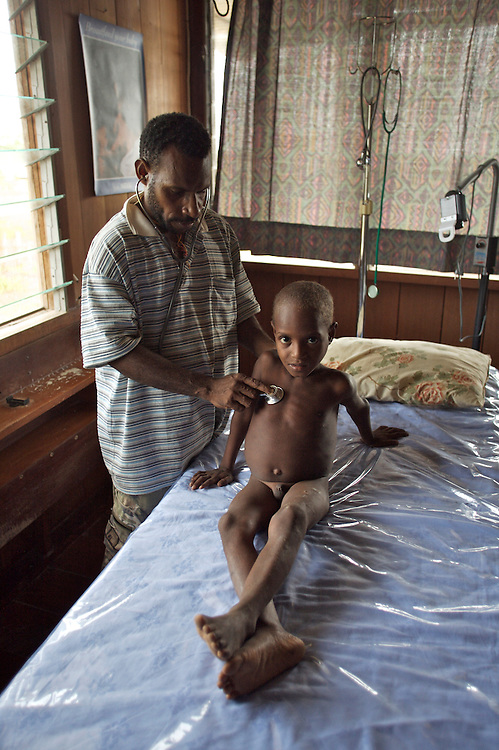 simpson a young boy from wangamalo is examined by lander at the wangamalo clinic
