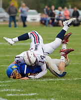 Plymouth's Anthony Velez and Gilford-Belmont's Evan Merrifield get wrapped up during a tackle at Saturday's NHIAA Division II football at the Meadows Field.  (Karen Bobotas/for the Laconia Daily Sun)