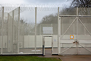 The secure perimeter fence and gates. HMP Send, closed female prison. Ripley, Surrey.