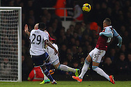 Picture by David Horn/Focus Images Ltd +44 7545 970036<br /> 23/11/2013<br /> Ravel Morrison of West Ham United (right) cannot prevent a shot from Samuel Eto'o of Chelsea during the Barclays Premier League match at the Boleyn Ground, London.