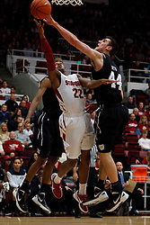Dec 22, 2011; Stanford CA, USA;  Butler Bulldogs center Andrew Smith (44) blocks a shot from Stanford Cardinal guard Jarrett Mann (22) during the first half at Maples Pavilion.  Mandatory Credit: Jason O. Watson-US PRESSWIRE