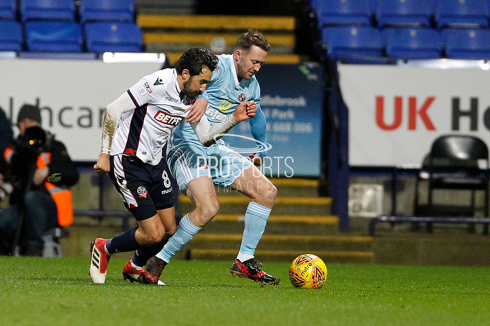 Sunderland midfielder Aidan McGeady (19) and Bolton Wanderers midfielder Jem Karacan (8) during the EFL Sky Bet Championship match between Bolton Wanderers and Sunderland at the Macron Stadium, Bolton, England on 20 February 2018. Picture by Craig Galloway.