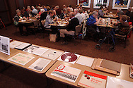 After talking and looking over the items on display, chorus members and guests have lunch during a reunion of Inland Children's Chorus members at MCL Restaurant & Bakery in Kettering, Saturday, April 27, 2013.