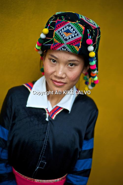 Teen girl wearing a Hmong Lai traditional dress.