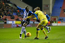 Marc-Antoine Fortune of Wigan is challenged by Glenn Loovens of Sheffield Wednesday - Photo mandatory by-line: Rogan Thomson/JMP - 07966 386802 - 30/12/2014 - SPORT - FOOTBALL - Wigan, England - DW Stadium - Wigan Athletic v Sheffield Wednesday - Sky Bet Championship.
