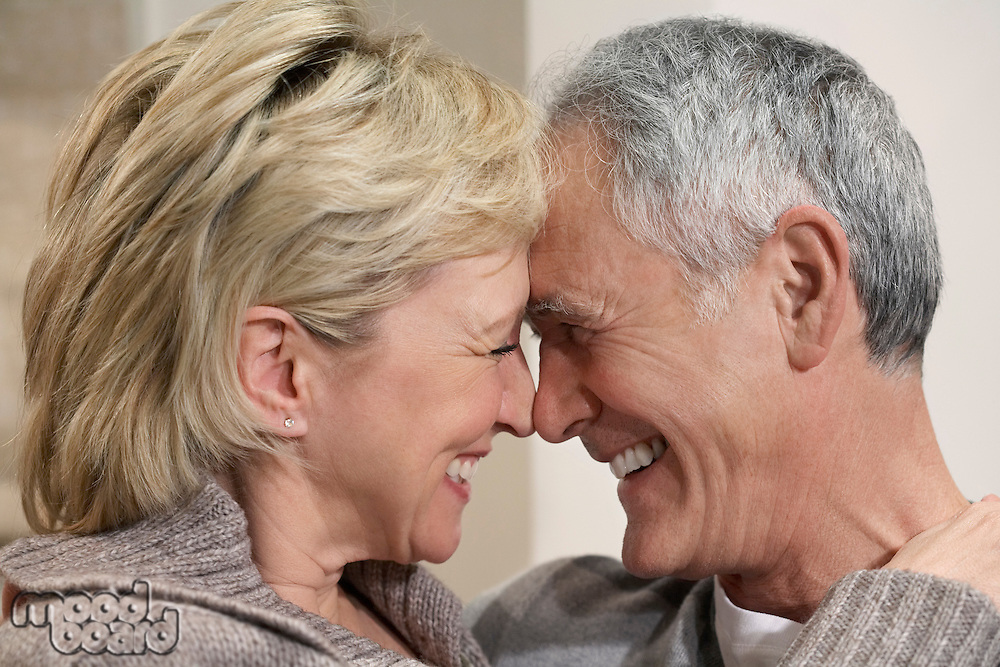 Middle-aged couple hugging close-up