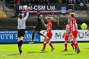 Marek Rodak (12) of Accrington Stanley punched the ball away from Jake Jervis (14) of Plymouth Argyle during the EFL Sky Bet League 2 match between Plymouth Argyle and Accrington Stanley at Home Park, Plymouth, England on 1 April 2017. Photo by Graham Hunt.