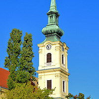 St. Catherine of Alexandria Church in Budapest, Hungary<br /> Initially, Tabán was a Medieval village below the Buda Castle populated by Turks. It later became a Bohemian neighborhood. Franciscans established a Catholic parish here in the 17th century and built St. Catherine of Alexandria in 1736. This clock tower was added in 1753 and restored in the late 19th century. During the 1930s, most of the surroundings buildings were leveled as part of an urban development program. Fortunately, this church was spared.