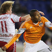 Ricardo Clark, (right), Houston Dynamo, challenged by Dax McCarty, New York Red Bulls, during the New York Red Bulls V Houston Dynamo, Major League Soccer regular season match at Red Bull Arena, Harrison, New Jersey. USA. 23rd April 2014. Photo Tim Clayton