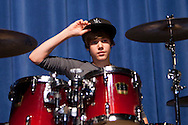 SANFORD, FL -  AUGUST 5  Justin Bieber performs for band camp students at Seminole High School in Sanford, Florida, on August 5, 2010. Bieber was on hand as part of a Best Buy and Grammy Foundation donation to the music program at Seminole High School.(Photo by Matt Stroshane/Getty Images)
