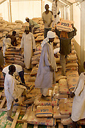Food distribution for the Breidjing Refugee Camp in eastern Chad, run by the U.N. World Food Programme, is very systematic. Following a precise schedule, workers distribute food, including bags of corn-soy mixture and sorghum to block leaders, who then parcel it out to families. Hungry Planet: What the World Eats (p. 60). /// This image is featured alongside the Aboubakar family images in Hungry Planet: What the World Eats. (Please refer to Hungry Planet book p. 56-57 for a family portrait.)