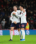 Jordan Henderson (14) of Liverpool and Curtis Jones (48) of Liverpool celebrate the 3-0 win at full time during the Premier League match between Bournemouth and Liverpool at the Vitality Stadium, Bournemouth, England on 7 December 2019.