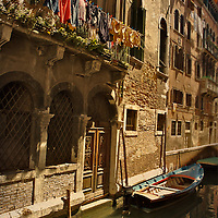 Washing hanging up on a balcony above a canal in Venice, Italy