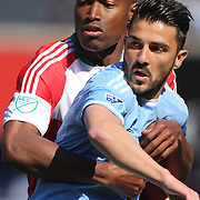 David Villa, NYCFC, is closely marked by Jose Goncalves, New England Revolution, during the New York City FC Vs New England Revolution, MSL regular season football match at Yankee Stadium, The Bronx, New York,  USA. 26th March 2016. Photo Tim Clayton