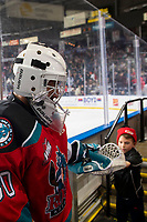 KELOWNA, BC - DECEMBER 18:  Roman Basran #30 of the Kelowna Rockets fist bumps a fan on his way to the dressing room at the end of second period against the Vancouver Giants at Prospera Place on December 18, 2019 in Kelowna, Canada. (Photo by Marissa Baecker/Shoot the Breeze)