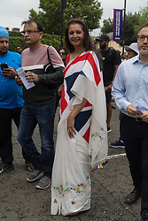 A woman wears a Sari in England colours as crowds flock to Lords Cricket Ground, the Home of Cricket to watch the ICC Cricket World Cup final between England and New Zealand. London, July 14 2019.