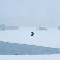 Ice Fishing during a snow storm on Lake Winnipesaukee.  <br /> <br /> All Content is Copyright of Kathie Fife Photography. Downloading, copying and using images without permission is a violation of Copyright.