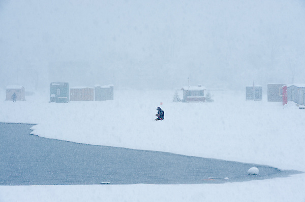 Ice Fishing during a snow storm on Lake Winnipesaukee.  <br />