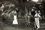 western tourists one dressed up in Moroccan traditional clothing posing in garden Morocco Rabat 1930s