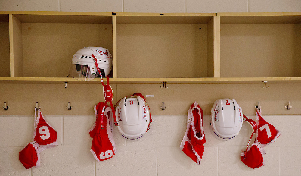 Hockey helmets and uniforms, which provide little coverage on the field, hang in the locker room before the Omaha Heart's opening game against the Atlanta Steam in Gwinnett, Ga., on Saturday, April 13, 2013. The Legends Football League, formerly the Lingerie Football League, has moved away from the implications of its former name, though the uniforms remain scant.<br />