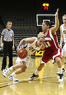 19 February 2009: Iowa guard Kristi Smith (11) tries to drive around Wisconsin guard Rae Lin D'Alie (11) during the first half of an NCAA women's college basketball game Thursday, February 19, 2009, at Carver-Hawkeye Arena in Iowa City, Iowa. Iowa defeated Wisconsin 72-65.