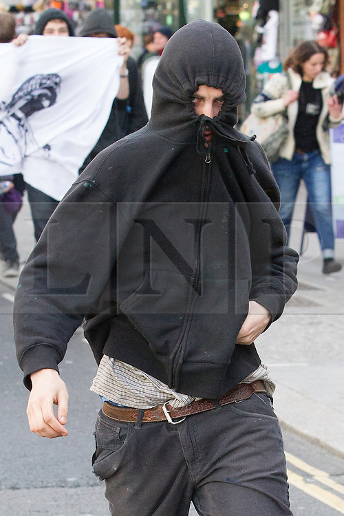 © Licensed to London News Pictures . 21/04/2013 . Brighton , UK . A black bloc protester opposed to the march . Nationalist group March for England hold a march along Brighton seafront today (Sunday 21st April) . The group was supported by supporters of the English Defence League and opposed by anti fascist and left wing groups . The annual march takes place close to St George's Day and frequently results in scuffles and violence between opposing groups and police . Photo credit : Joel Goodman/LNP