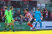 Ball deflects off Forest Green Rovers midfielder Marcus Kelly (10) who scores an own goal to make the score 2-1 during the Vanarama National League match between Lincoln City and Forest Green Rovers at Sincil Bank, Lincoln, United Kingdom on 25 March 2017. Photo by Simon Davies.