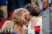 CBS Sports reporter Lesley Visser (left) gets cozy with actress and Kentucky Wildcats fan Ashley Judd during the game against the Iowa State Cyclones during the third round of the NCAA men's basketball championship on March 17, 2012 at KFC Yum! Center in Louisville, Kentucky. Kentucky advanced with an 87-71 win. (Photo by Joe Robbins)