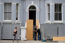 © Licensed to London News Pictures. 25/08/2016. London, UK. A residential property being boarded up in Notting Hill ahead of the annual Notting Hill Carnival which starts this bank holiday weekend. Photo credit: Ben Cawthra/LNP