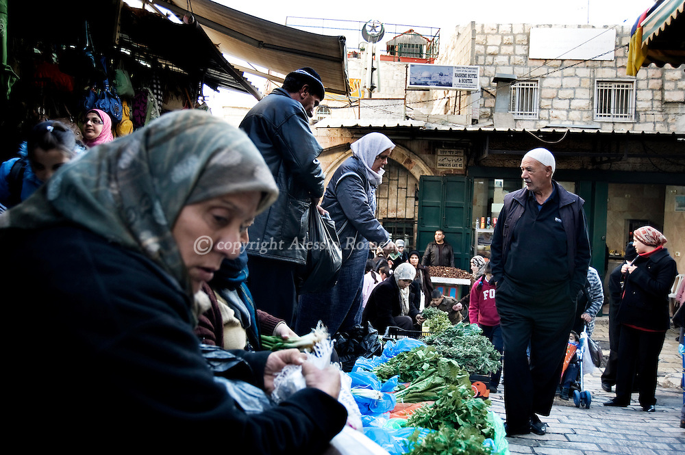 .JERUSALEM : Palestinians walk near Damascus gate in Jerusalem's Old City, on December 08, 2009. Israel and the Palestinians welcomed an EU statement that Jerusalem should be the capital of both the Jewish state and a future Palestinian state..© ALESSIO ROMENZI