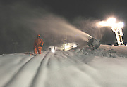 Boyne Highlands Resort night crew employee Dave Sheriff makes his way through one of the resorts lines of snow guns that run 24 hours a day to get ready for the upcoming ski season.