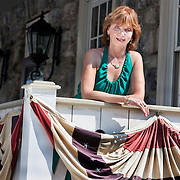 "Best-selling author Nora Roberts on the porch of the Inn at  Boonsboro in historic Boonsboro, Maryland. Ms. Roberts bought the 1790s-era building and created an eight-room boutique hotel meant to cater to women's romantic sides...Rooms are named for famous literary couples, including Marguerite and Percy of ""The Scarlet Pimpernel"" and Jane and Rochester from ""Jane Eyre."" Ms. Roberts spent $3 million renovating the three-story inn."