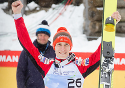 Winner Jurij Tepes of Slovenia celebrates during trophy ceremony after the Flying Hill Individual Event at 4th day of FIS Ski Jumping World Cup Finals Planica 2013, on March 24, 2013, in Planica, Slovenia. (Photo by Vid Ponikvar / Sportida.com)