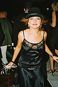 Woman wearing evening dress and a bowler hat on the dancefloor, Posh at Addington Palace, UK, August, 2004
