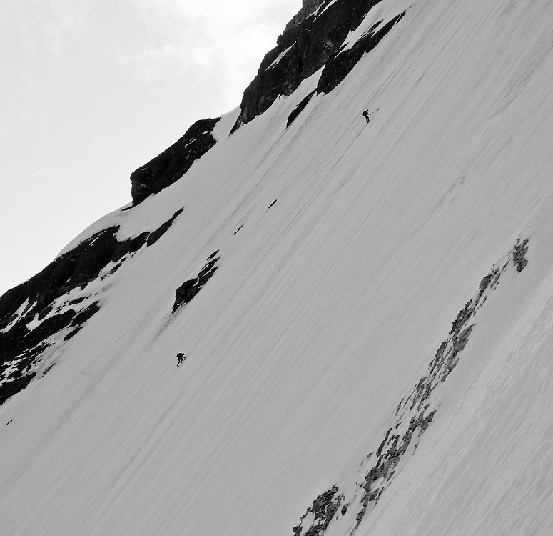 Alpine Climbers belaying up the second on  the North Face Mount Athabasca - Columbia Icefields - Jasper National Park - Alberta